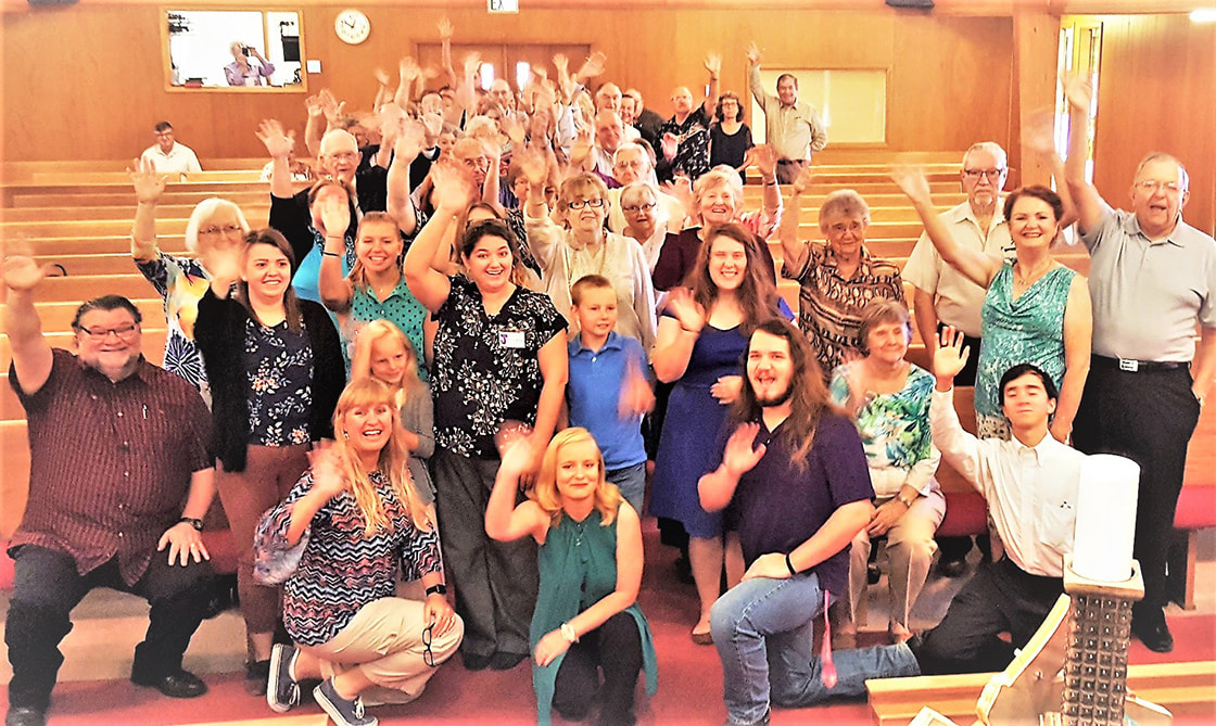 St. James church members wave to the camera